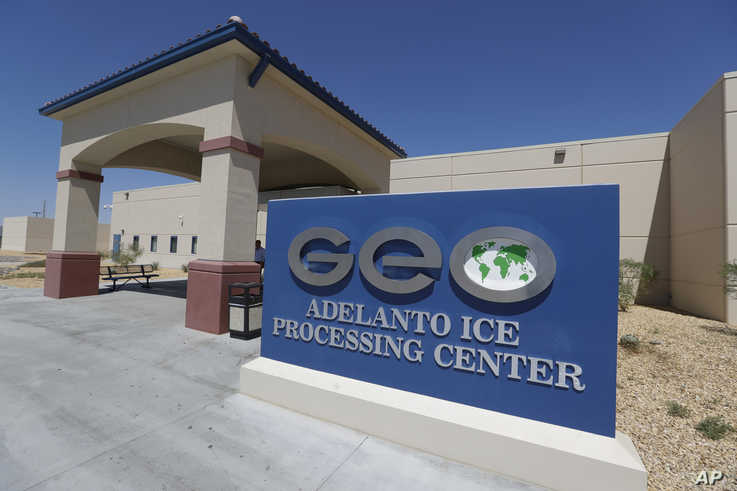 FILE - In this Aug. 28, 2019, file photo, the Adelanto U.S. Immigration and Enforcement Processing Center operated by GEO Group…