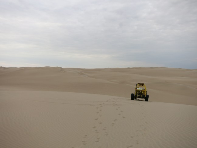 Dune buggy in the sands of Paracas desert, Peru