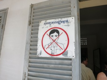 A sign at tuol sleng prison reminding you that visiting a prison is not a laughing matter.