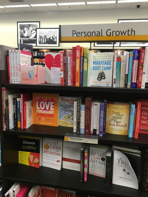 poem is on top shelf in front of book with heart on the cover