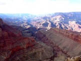 The Grand Canyon is known for its visually overwhelming size and its intricate and colorful landscape.