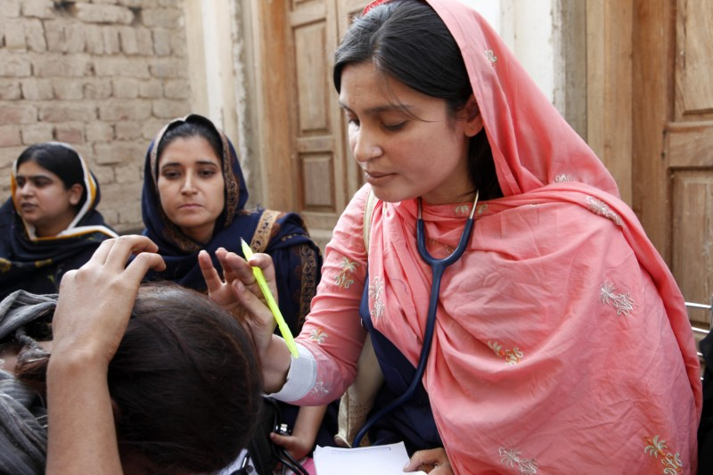 A female doctor with the International Medical Corps examines a woman patient at a mobile health clinic in Pakistan, which has to grapple with the effects of climate breakdown