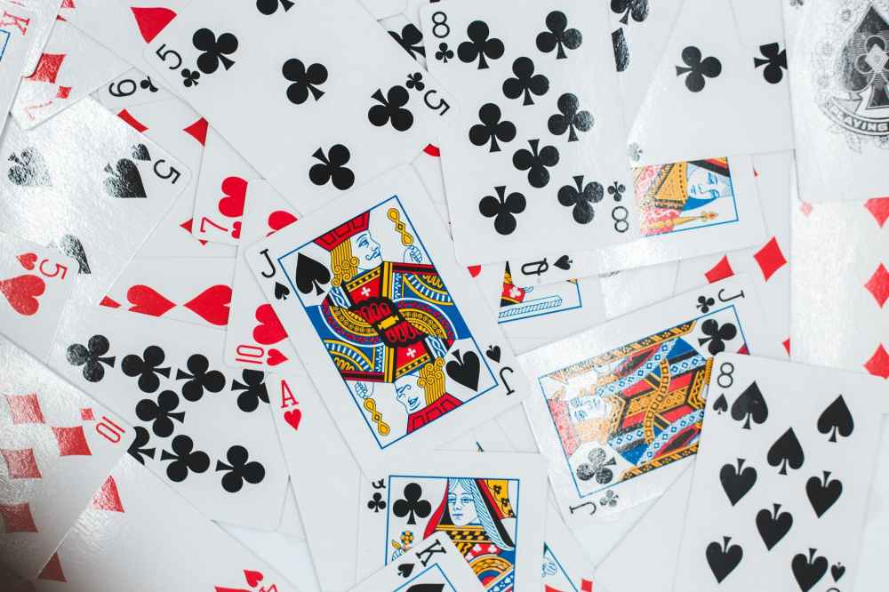 playing cards on white and black polka dot textile