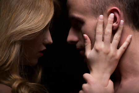 Portrait of sensual passionate couple looking at eyes