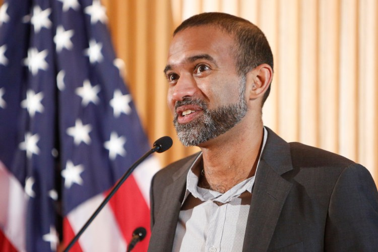 Poet Srikanth Reddy reads from and discusses his work during a Bagley Wright Lecture Series event hosted by the Poetry and Literature Center, September 10, 2015. Photo by Shawn Miller.