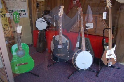 Green guitar in the window at Picker's Supply
