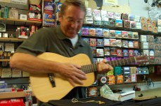 Brad playing guitar at Picker's Supply