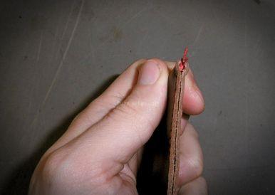 terminer une couture au point sellier, la technique du noeud caché