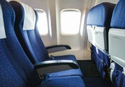 Economy class seat on airplane