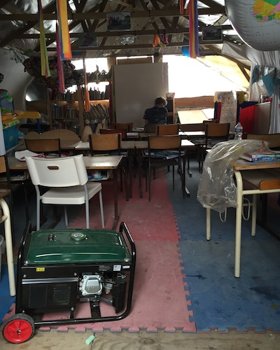 Makeshift classroom for elementary school kids in the Calais Jungle refugee camp