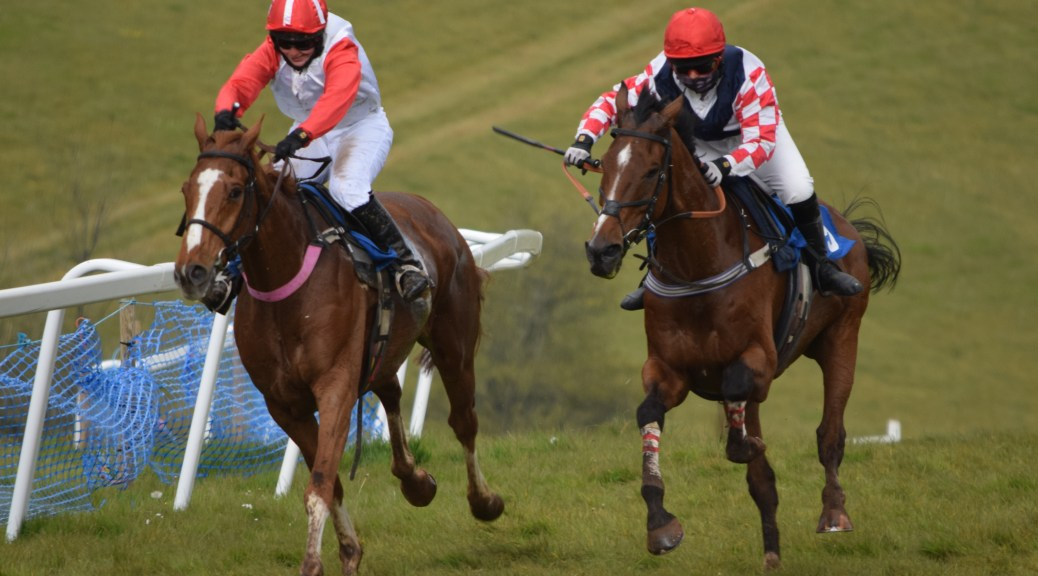 Ladies Open winner Board Of Trade ridden by Chloe Emsley (left) in a hard-fought battle with Southfield Theatre ridden by Lily Bradstock