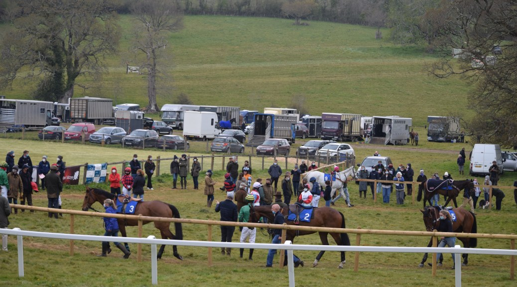 Runners parade in the paddock ahead of racing at Flete Park
