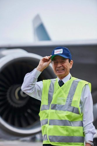 Engineer Higashi Ihoto wears his old uniform cap with a huge sense of pride. Photo by Cathay Pacific.