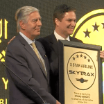 Edward Plaisted, Chairman of Skytrax, hands the 5-star certification to Peter Baumgartner, CCO of Etihad.