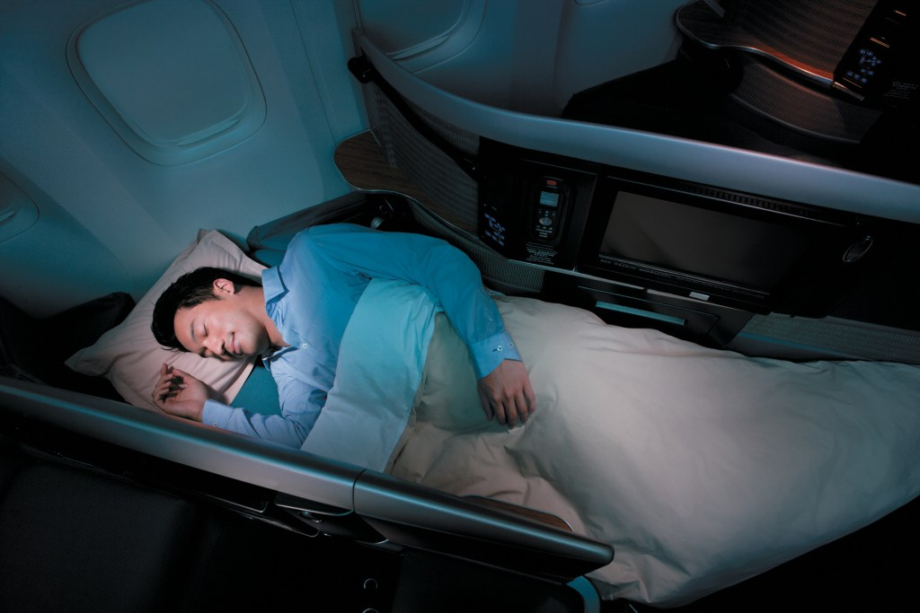 "Cathay Pacific's last generation, ""Coffin Style"" Business Class Seats. Source: Cathay Pacific"