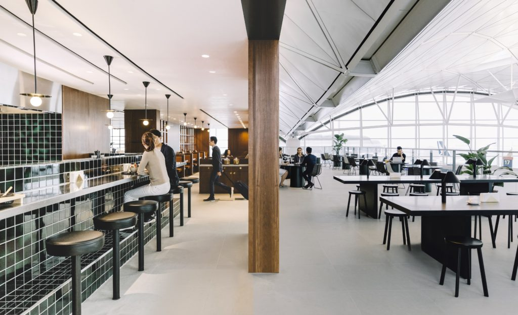 """The Deck lounge offers """"The Terrace,"""" an indoor balcony that overlooks the departure hall. Source: Cathay Pacific"""