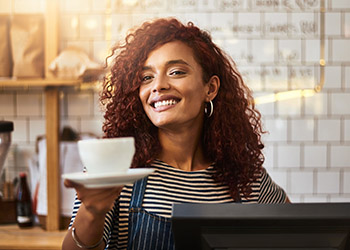 Pointofsale owner extending coffee cup restaurant pos