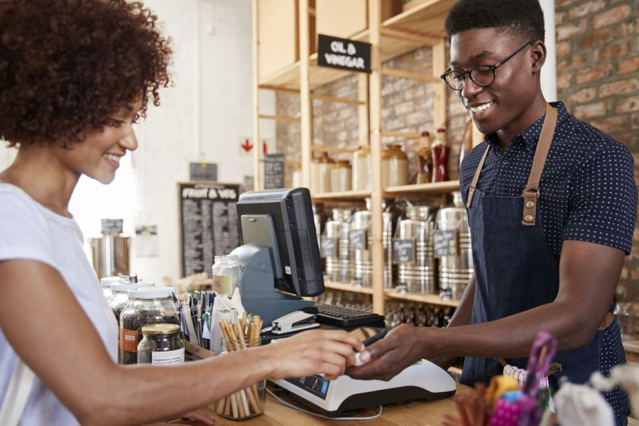 PointofSale Customer paying with contactless payment at counter Small Business Hiring