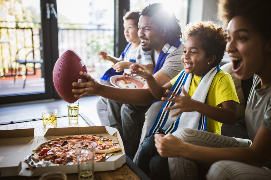 PointOfSale family cheering on football team super bowl catering
