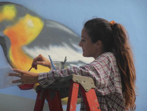 """""""There's a magic element about murals, where you can really transform a wall, a whole building, and create a different perception and elevate people's spirits,"""" Lueza says. """"When it's done right, it can be amazing."""""""