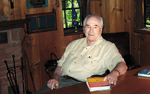 Ernie at Bill Wilson's Desk at Stepping Stones, with 1st edition Big Book (courtesy of Bill White)