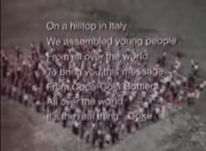 """The closing shot of Coca-Cola's iconic 1971 ad: """"On a hilltop in Italy, We assembled young people from all over the world To bring you this message From Coca-Cola Bottlers. All over the world It's the real thing."""""""