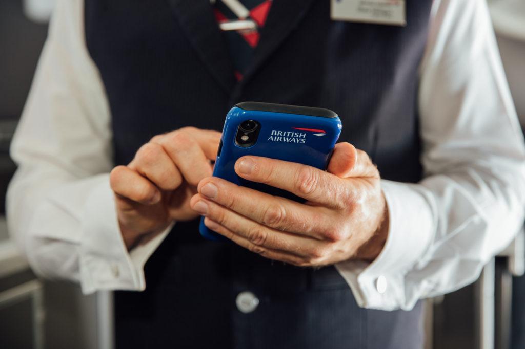 British Airways cabin crew using iPhone XR during a flight