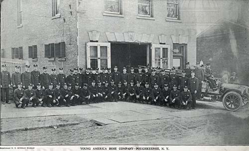 Vintage black and white photo of young men dressed in firemen's dress uniforms