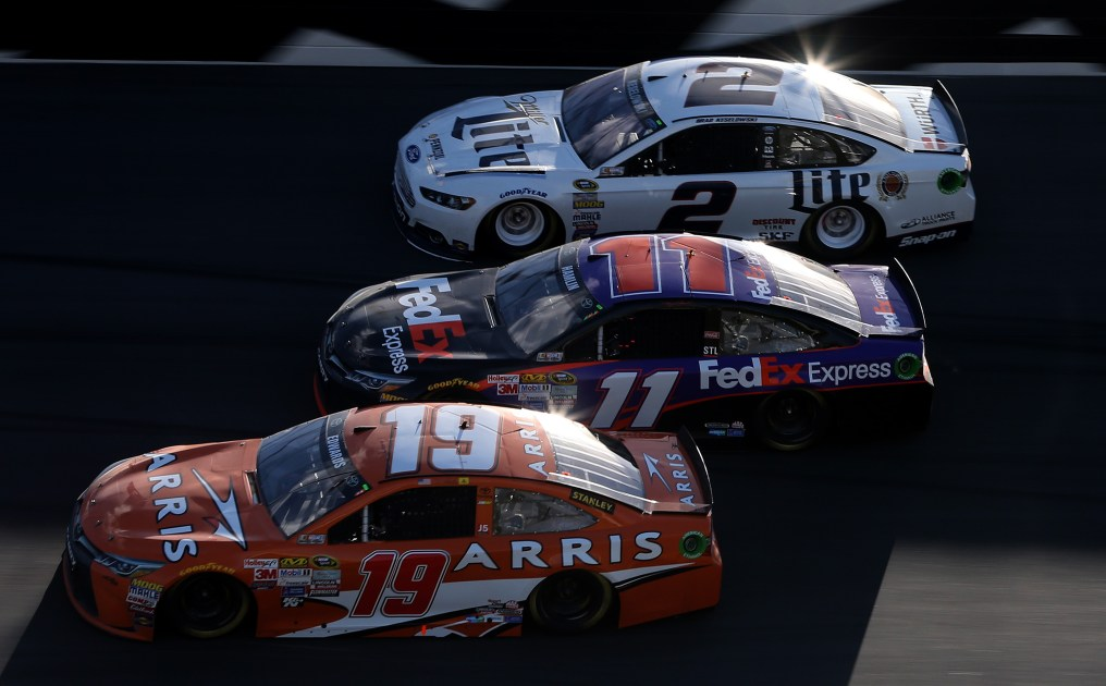 DAYTONA BEACH, FL - FEBRUARY 22: Carl Edwards, driver of the #19 Arris Toyota, Denny Hamlin, driver of the #11 FedEx Express Toyota, and Brad Keselowski, driver of the #2 Miller Lite Ford, race during the NASCAR Sprint Cup Series 57th Annual Daytona 500 at Daytona International Speedway on February 22, 2015 in Daytona Beach, Florida. (Photo by Brian Lawdermilk/Getty Images)