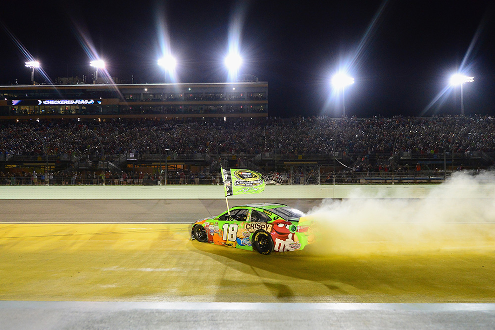HOMESTEAD, FL - NOVEMBER 22:  Kyle Busch, driver of the #18 M&M's Crispy Toyota, celebrates with a burnout after winning the series championship and the NASCAR Sprint Cup Series Ford EcoBoost 400 at Homestead-Miami Speedway on November 22, 2015 in Homestead, Florida.  (Photo by Jeff Curry/Getty Images)