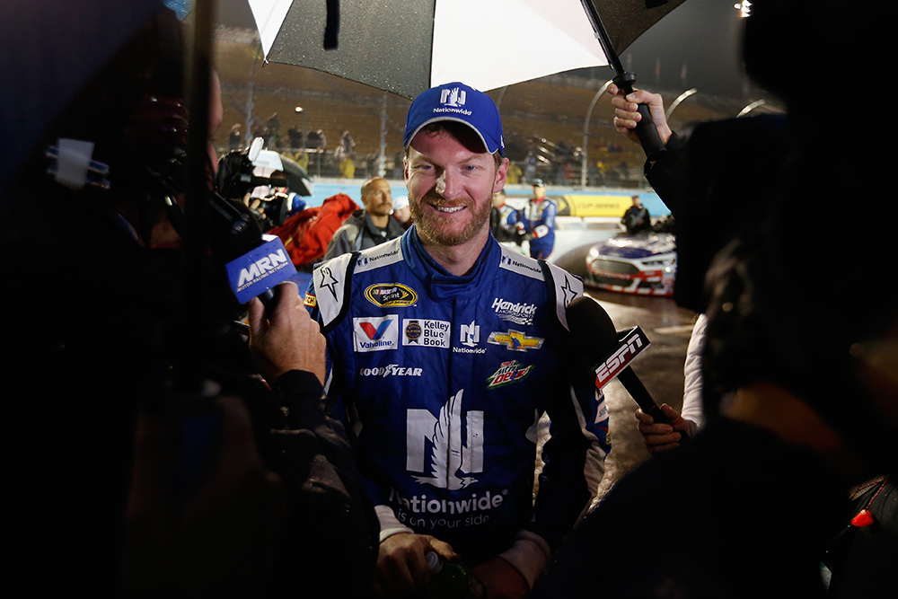 AVONDALE, AZ - NOVEMBER 15:  Dale Earnhardt Jr., driver of the #88 Nationwide Chevrolet, is interviewed on pit road after winning the rain-shortened NASCAR Sprint Cup Series Quicken Loans Race for Heroes 500 at Phoenix International Raceway on November 15, 2015 in Avondale, Arizona.  (Photo by Christian Petersen/Getty Images)