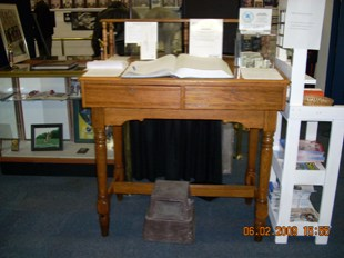 """""""Blotter Desk"""", circa 1890, where the blotter (diary) of each station was kept. This one was restored to original condition and now holds the museum blotter."""