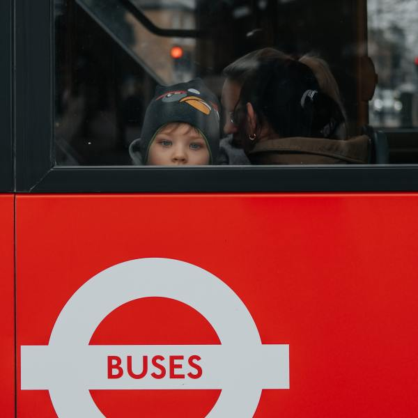 Photo of young child on a London bus to illustrate new research by Policy in Practice on the interaction of COVID-19 measures and the Benefit Cap on low-income Londoners
