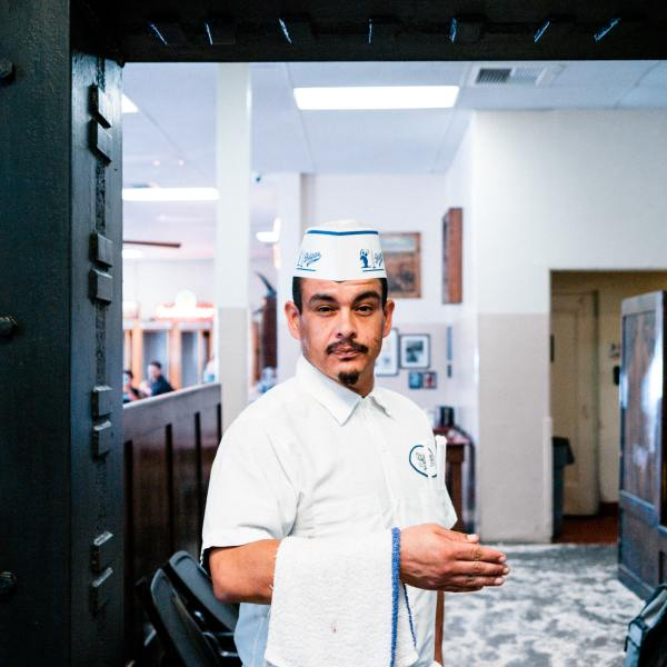 Photo of a waiter to illustrate a blog post by Policy in Practice about the changes in the world of work and how the benefit system needs to adapt
