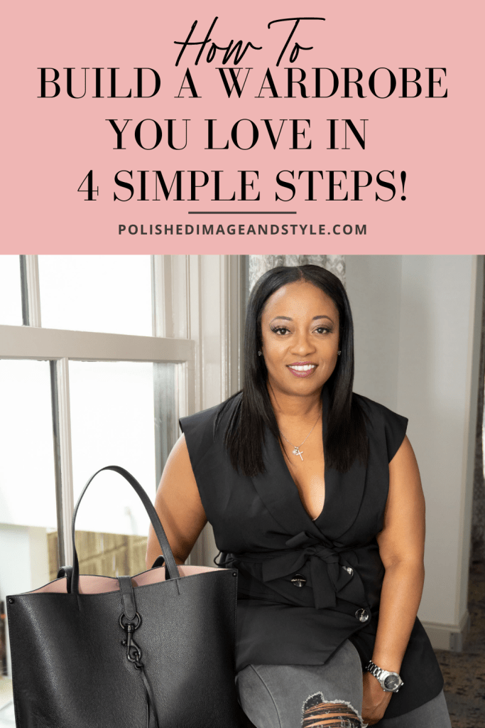 How to Build a Wardrobe You Love in 4 Simple Steps! | Image of Robin Fisher ready for business in a sleek black sleeveless top with dainty silver necklace and soft glam smiling at the camera next to her stylish black tote