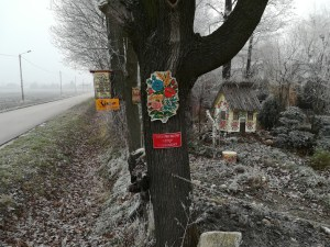 a tree in the Polish village of Zalipie decorated with a painted floral motif
