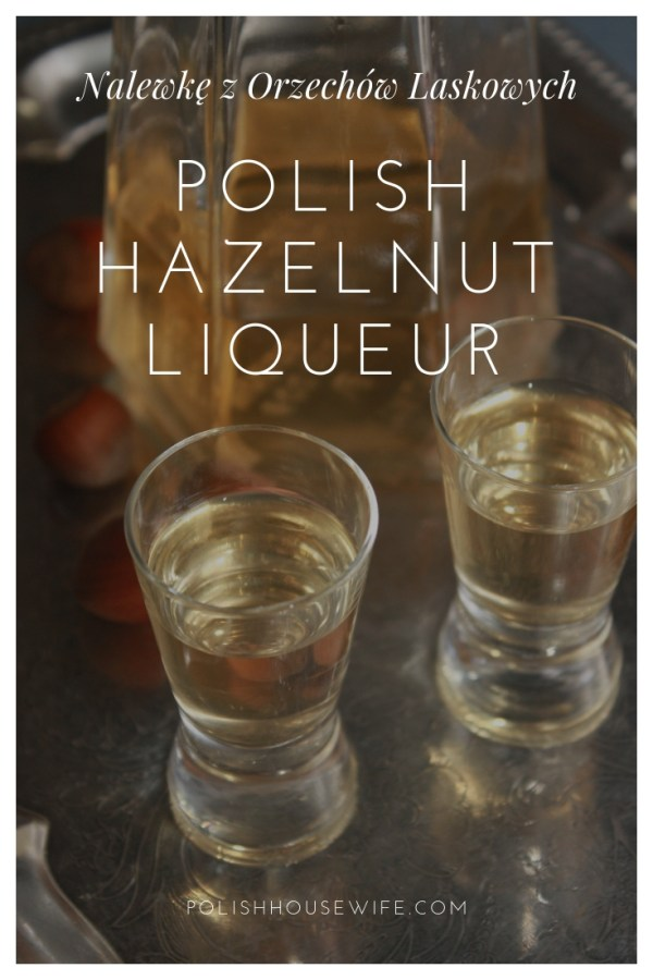 Polish hazelnut liqueur in two shot glasses on a silver tray with a bottle in the background