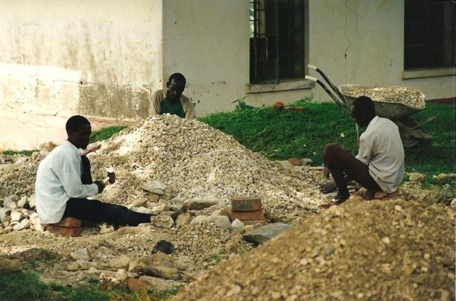 breaking stones to make agregate for concrete in uganda, east africa