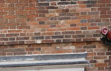 old brickwork replaced and repaired