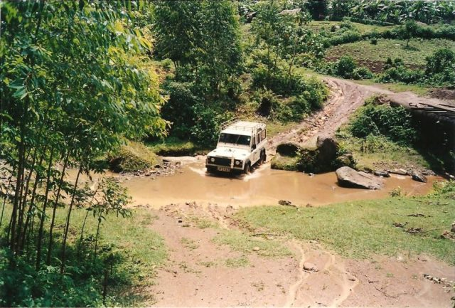 driving through a river in a landrover in mbale uganda