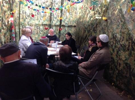 Studiyng Talmud in the Sukka on Shabbat morning