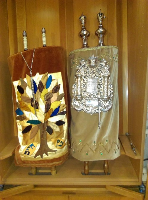 New Torah from MA with its beautify silver breast plate and yad placed in the ark in preparation of March 24 welcoming ceremony