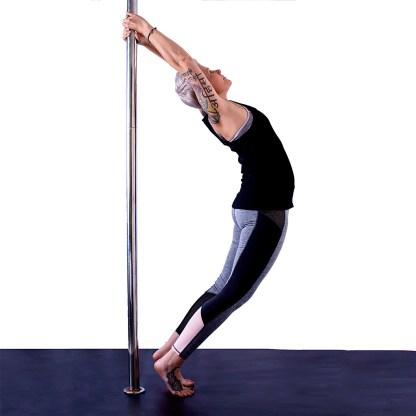 Jen performing pole yoga pose 2 at Polistic Plus studio