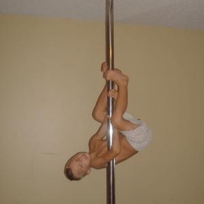 Child climbing pole.