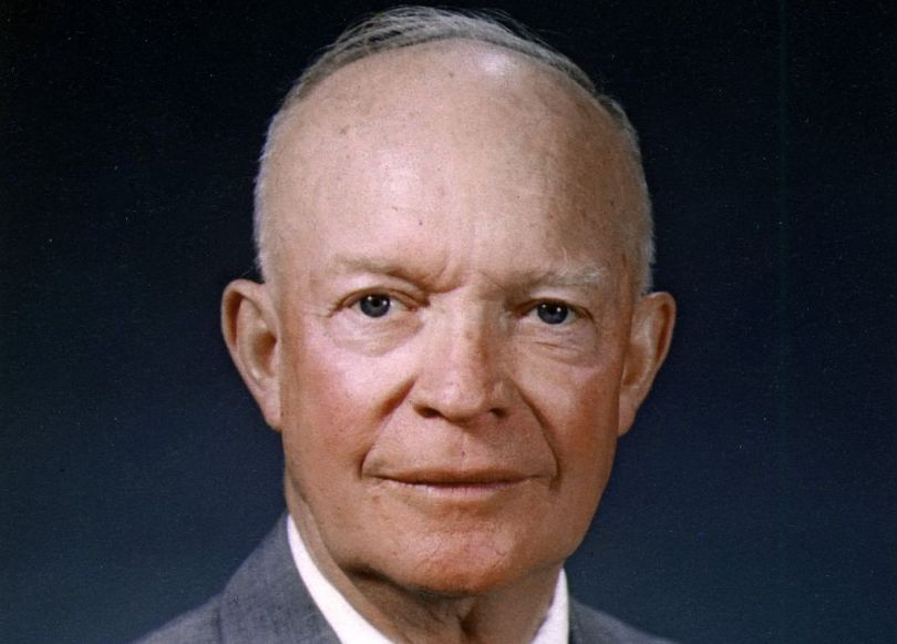 Facts about Dwight D. Eisenhower: The official presidential photograph of Dwight D. Eisenhower, with him staring into the camera in front of a blue backdrop
