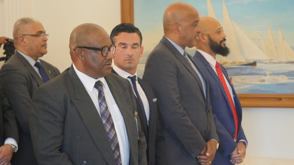 New faces (l-r): Kenneth Bascome, Jeff Baron, Cole Simons and Sylvan Richards at Government House this afternoon. Behind them is Works Minister Craig Cannonier.