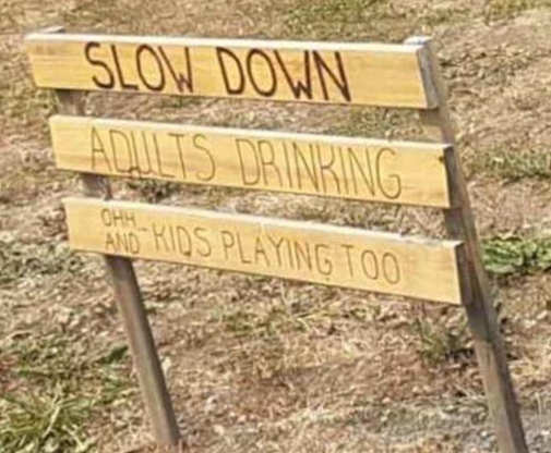slow down adults drinking oh and kids playing sign
