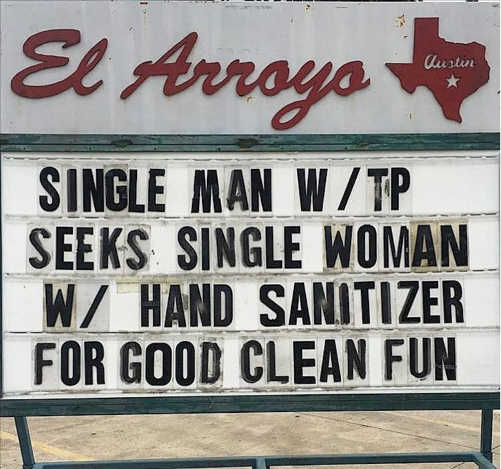 single man with tp and hand sanitizer for good clean fun sign