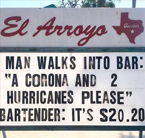 sign man walks into bar corona 2 hurricans cost 2020
