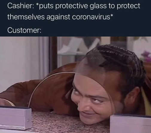 cashier puts protective glass coronavirus customer putting face through